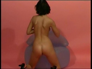 Brunette hottie on blowup chair