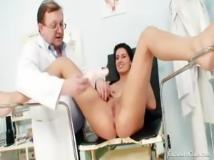 Long-haired brunette babe visits the doctor for the usual kinky checkup