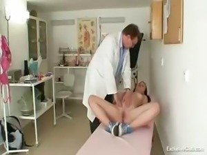 Kinky old gyno doctor butt plugs a skinny gal and examines her with a speculum
