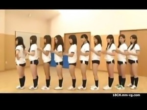 Young Asian schoolgirls line up to have a turn getting drilled by the teacher