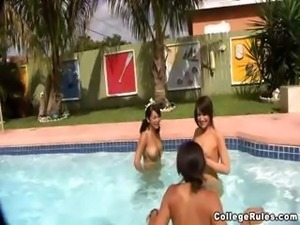 Naughty young coeds have a naked pool party and play pool games