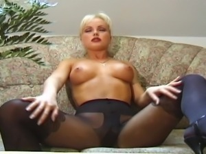 Fantastic blonde MILF in pantyhose is so sexy as she caress her big tits and...