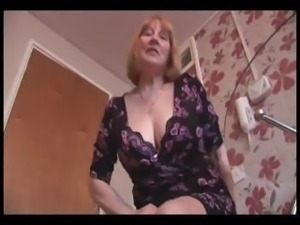 Attractive busty granny and teases then shows off her hairy plump pussy
