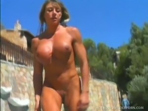Muscle girl works out outside before being double teamed