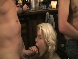 Public bar fucking as horny blonde babe enjoys hot gang banging