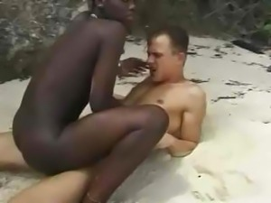 Hairy African girl fuckin euro guy in beach