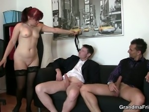 Red head granny gulping for two big young cocks in hot threesome