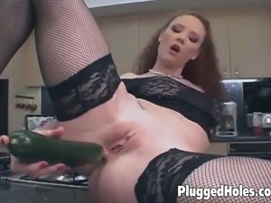 Busty redhead in black stockings loves drilling her ass with big dildos