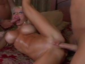 25 year old blonde with legendary 34FF tits fucks 2 buff studs.