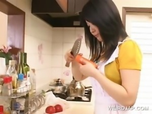 Asian hottie having fun in the kitchen