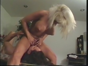 Buxom blonde gets sex and creampie action in bedroom