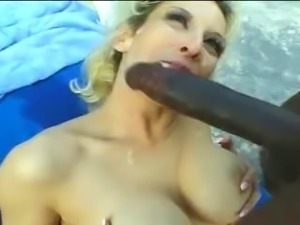 Busty blond MILF sucks and fucks a black man.