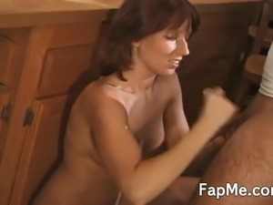 Stunning redhead takes a huge hard cock in her hands and strokes it in the...