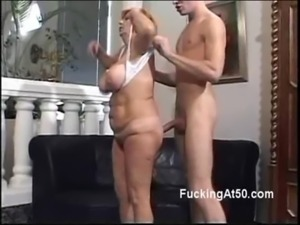 Horny redhead granny gives a young stud a naughty blowjob free