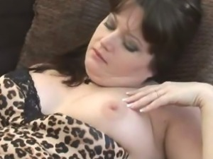 Busty gorgeous Milf strips to show nice plump pussy