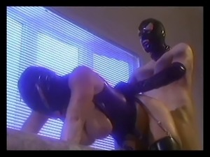 Guy fucking girl in the leather mask