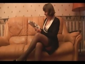 Hairy Granny in stockings plays with panties then strips
