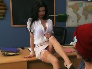 Beautiful teacher seduces student in the classroom