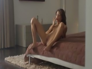 Exotic beauty rubbing clit in art movie