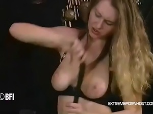 Blonde fetish babe loves to masturbate with a whip while being dressed in a...