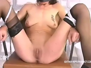 Brunette mother needs to sit down in the chair completely naked. The guy ties...