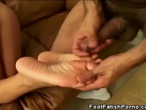 We have this lovely babe in this clip as she gives her man a nasty footjob....