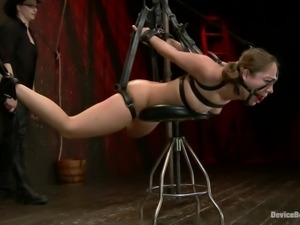 tied with leather belts and hanged