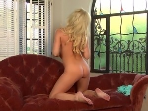 sexy blonde chick playing with her pussy.