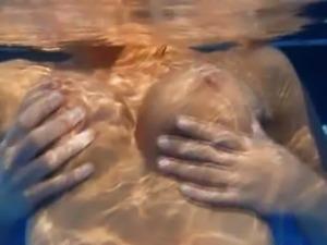 Underwater strip of beautiful chest