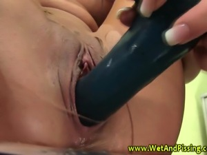 Pissing loving slut wetting her pussy with her urine