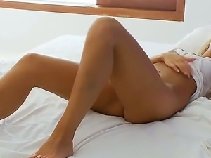 Gorgeous natural blonde Megana likes posing for the camera naked, showing...