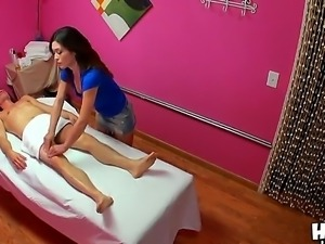 The obedient brunette Asian babe Noni Luv makes a good massage and handjob to...