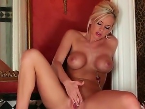 Marvelous blonde babe with huge fake boobs Lacey Foxx rubbing her nice pussy