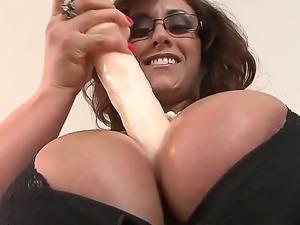 The amazing pornstar Eva Notty with a colossal boobies plays with a dildo...
