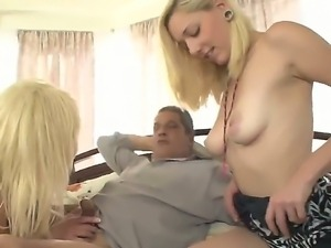 Gorgeous blonde babe Isabela and playmate enjoy sucking and licking a huge...