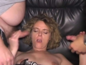 Naughty wife Lindy gangbanged by a couple of strangers at the Adult Theater.