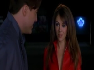 Elizabeth Hurley showing some excellent cleavage while wearing a sexy devil...
