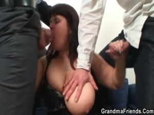 Huge titted woman takes two cocks free