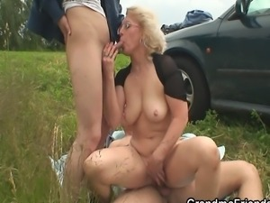Blonde granny has threesome outdoors