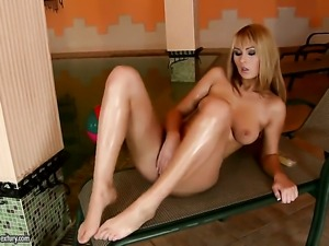 Blonde Antonya poses seductively before masturbating