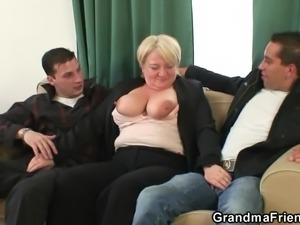 mature blonde and two dicks