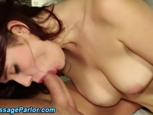 Redhead masseuse sucks cock
