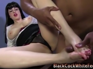Interracial fetish slut gets her sexy feet cummed on