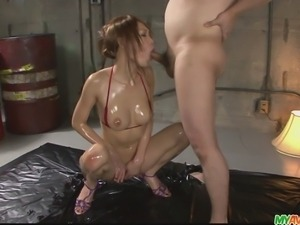 Nasty and oiled up chick in bikini teasing, flaunting her pack of fine and...