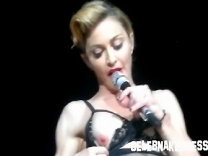 Celeb madonna flashing her bare breasts onstage during concert