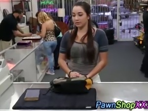 Real brunette flashes her tits at pawn shop