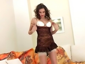 Leggy glamour babe strip and tease in sheer thigh high nylon and high heels