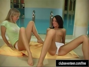 Superb young busty lesbian babes toying their petite muffs at poolside