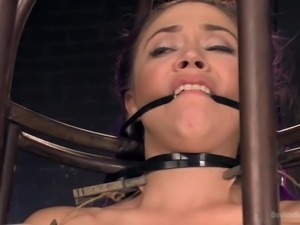 kristina gets tortured inside the cage