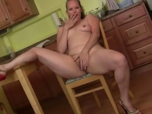 Two moms masturbating in the kitchen